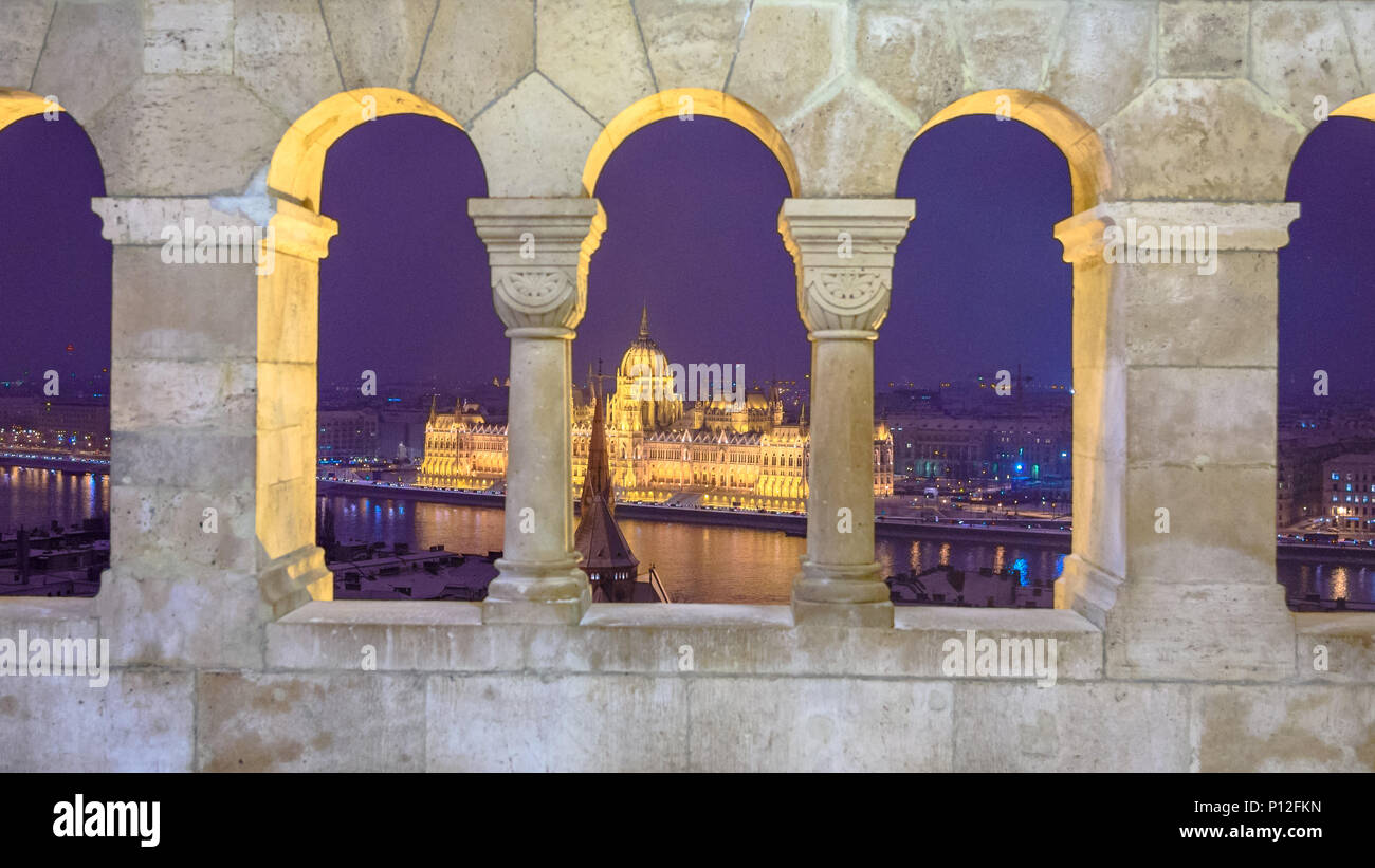 The Hungarian Parliament building seen through the windows of Fisherman's Bastion in Budapest in winter Stock Photo