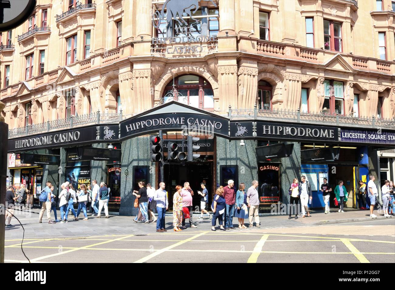 Hippodrome Casino, Leicester Square, London, UK showing people walking around in the sunshine.  Theatre and tourism area. - Stock Image