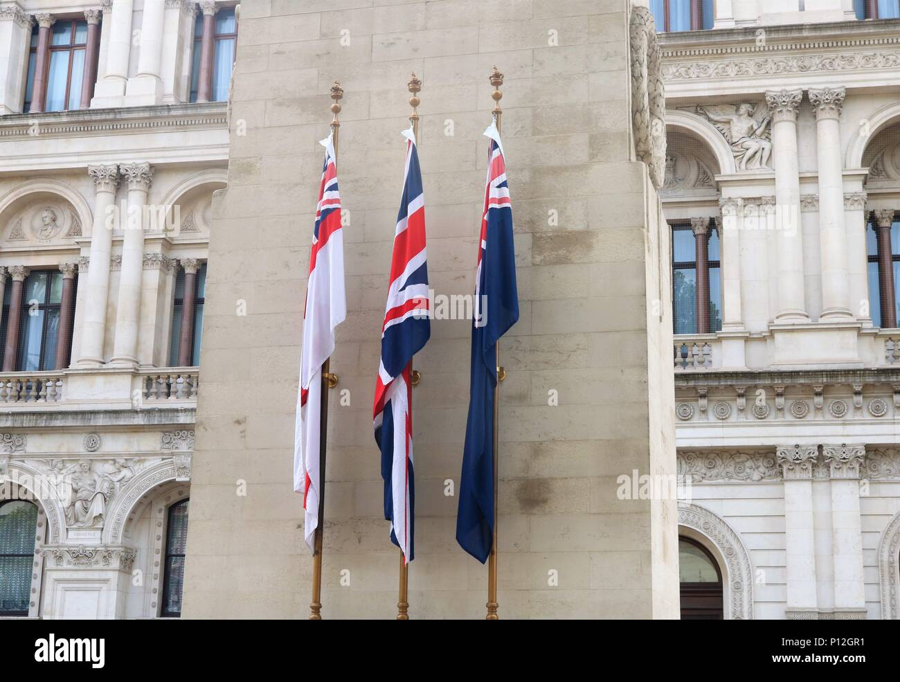 The White Ensign, Union Flag, and Blue Ensign Flags on the Cenotaph War Memorial at Whitehall, London, UK - Stock Image