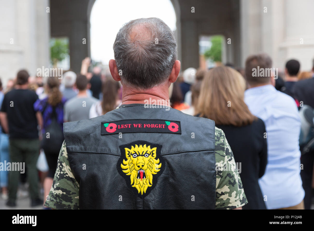 Biker or motorcyclist stands to attention during the daily Menin Gate ceremony, Ypres, Belgium - Stock Image