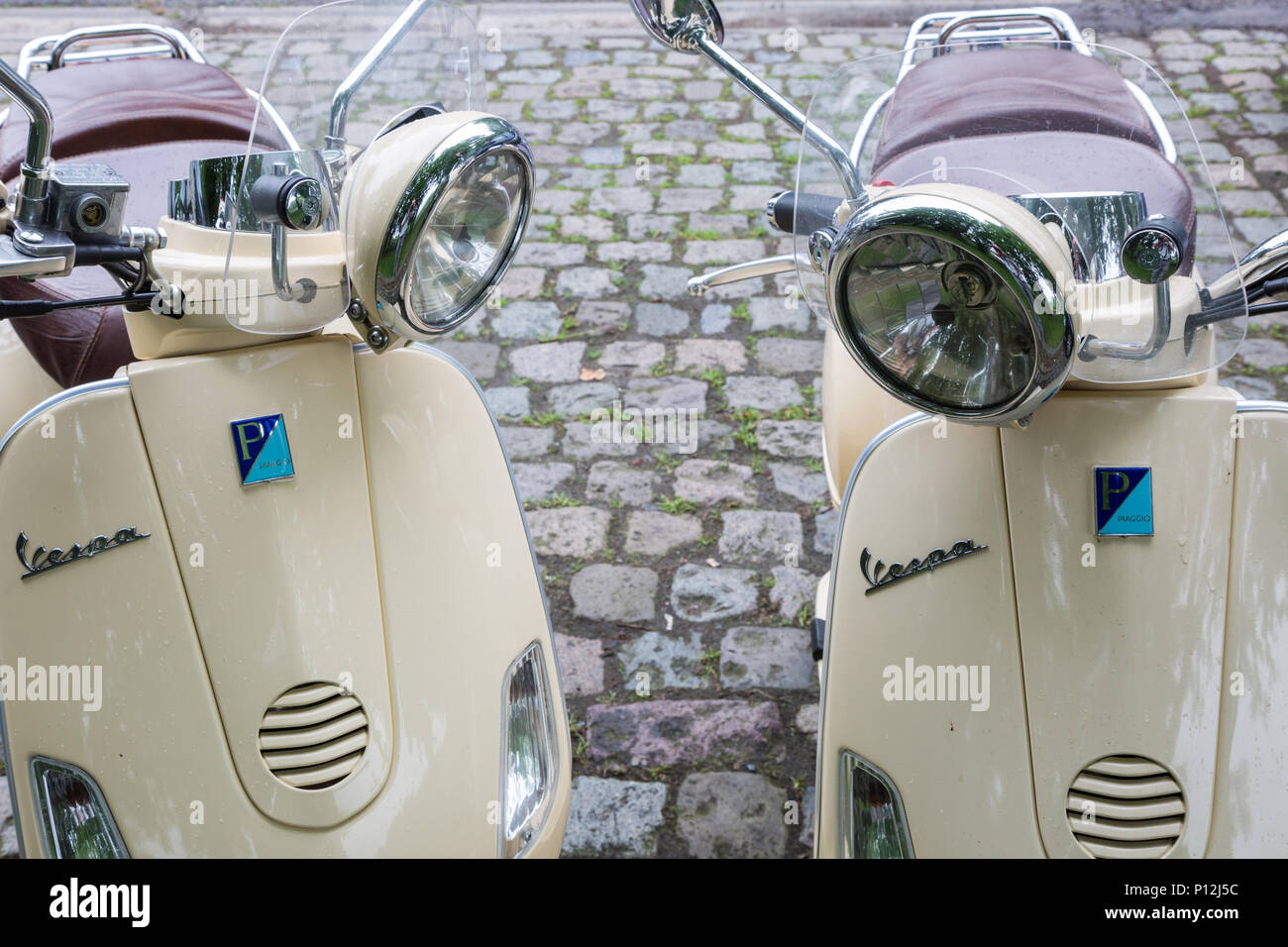Two Vespa LXV 125 scooters parked - Stock Image