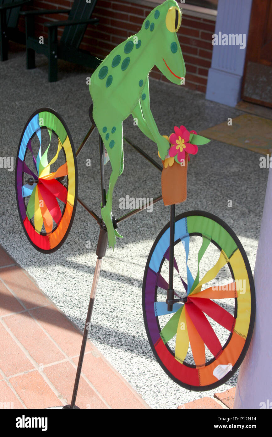 Frog on bicycle wind spinning toy Stock Photo