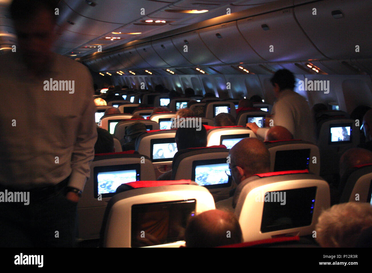 Interior of airplane during night flight - Stock Image