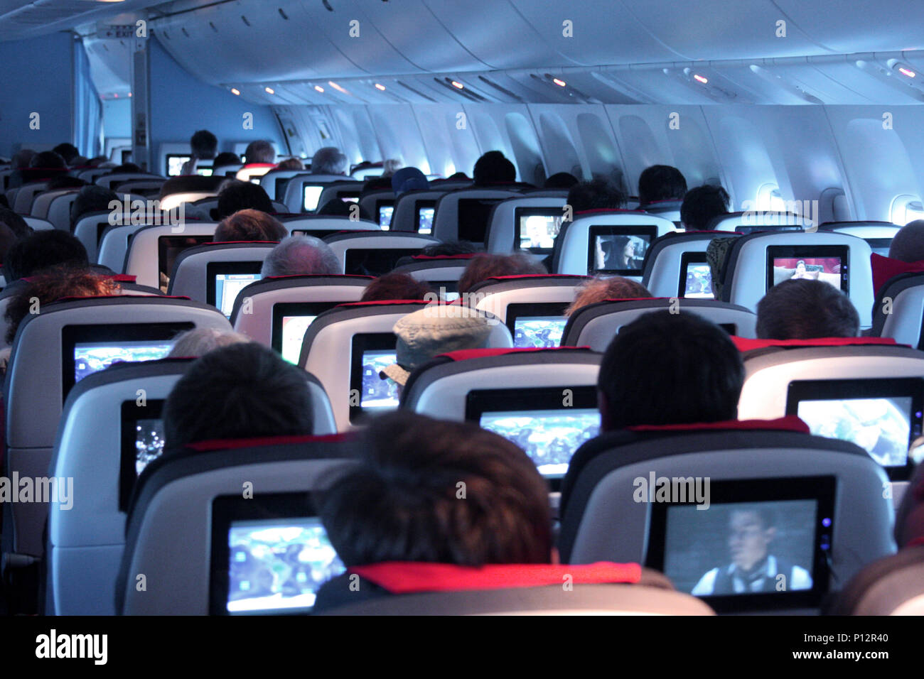 Interior of airplane during night flight - Stock Image