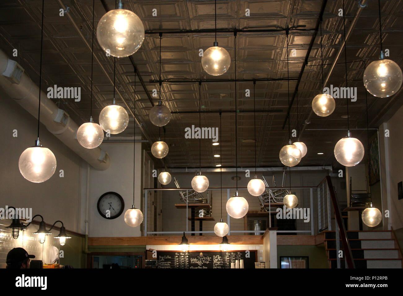 Modern light fixtures in restaurant - Stock Image