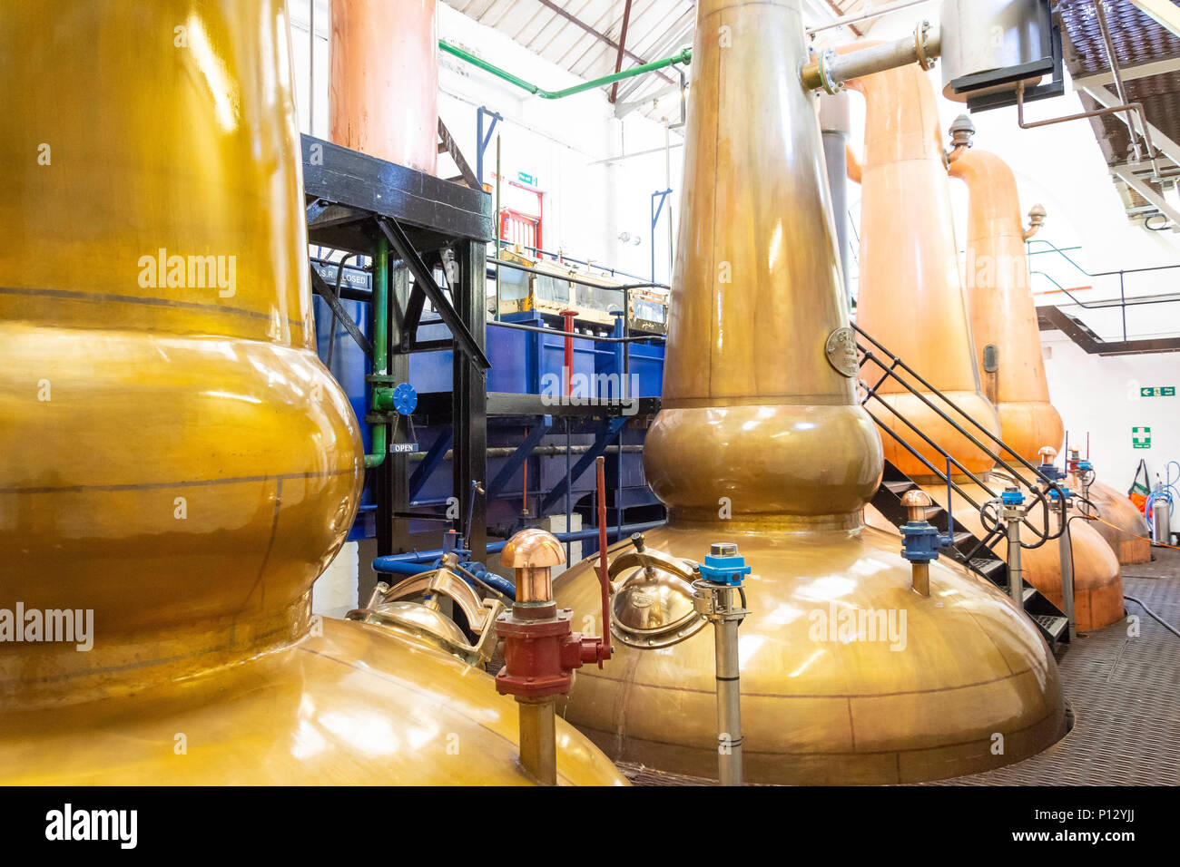 Copper sprit stills at Tobermory whisky distillery, Tobermory, Isle of Bute, Inner Hebrides, Argyll and Bute, Scotland, United Kingdom - Stock Image