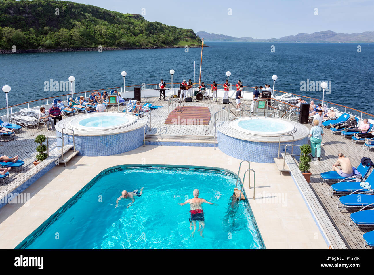'Sail away' entertainment onboard Fred Olsen 'Boudicca' cruise ship on leaving Tobermory, Isle of Bute, Inner Hebrides, Scotland, United Kingdom - Stock Image