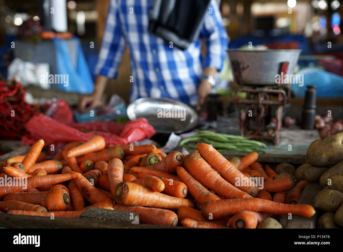 Banda Aceh, Aceh / Indonesia - May 25 2018  : Vegetable Vendor selling Fresh Organic carrot in farmer's market in Banda Aceh, Indonesia - Stock Image