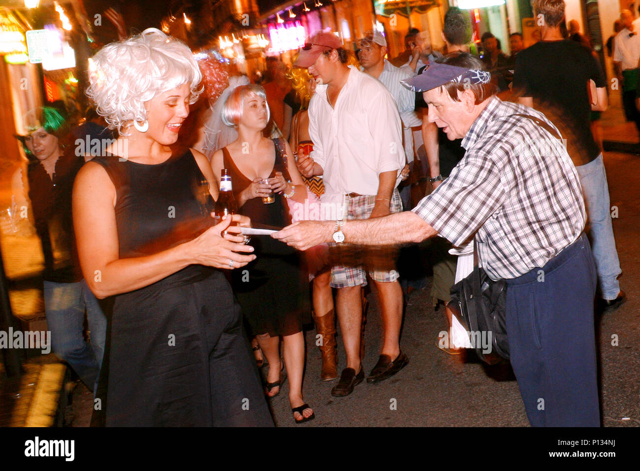 Handing out religious leaflets, Bourbon Street, French Quarter, New Orleans, Louisiana, USA - Stock Image