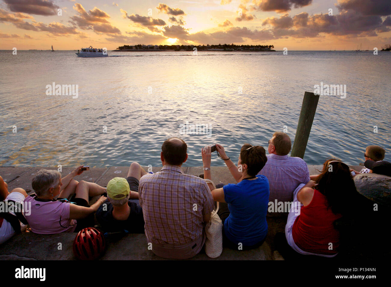 Watching the sun go down, Mallory Square, Key West, Florida, USA - Stock Image