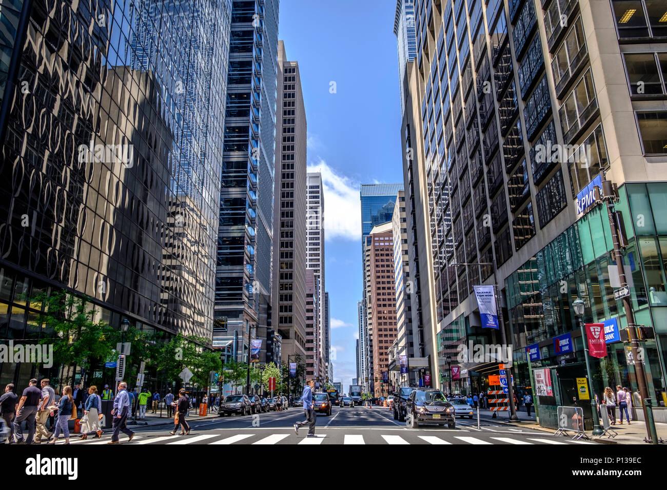Busy Market Street with crosswalk in downtown center city Philadelphia, Pennsylvania, USA - Stock Image