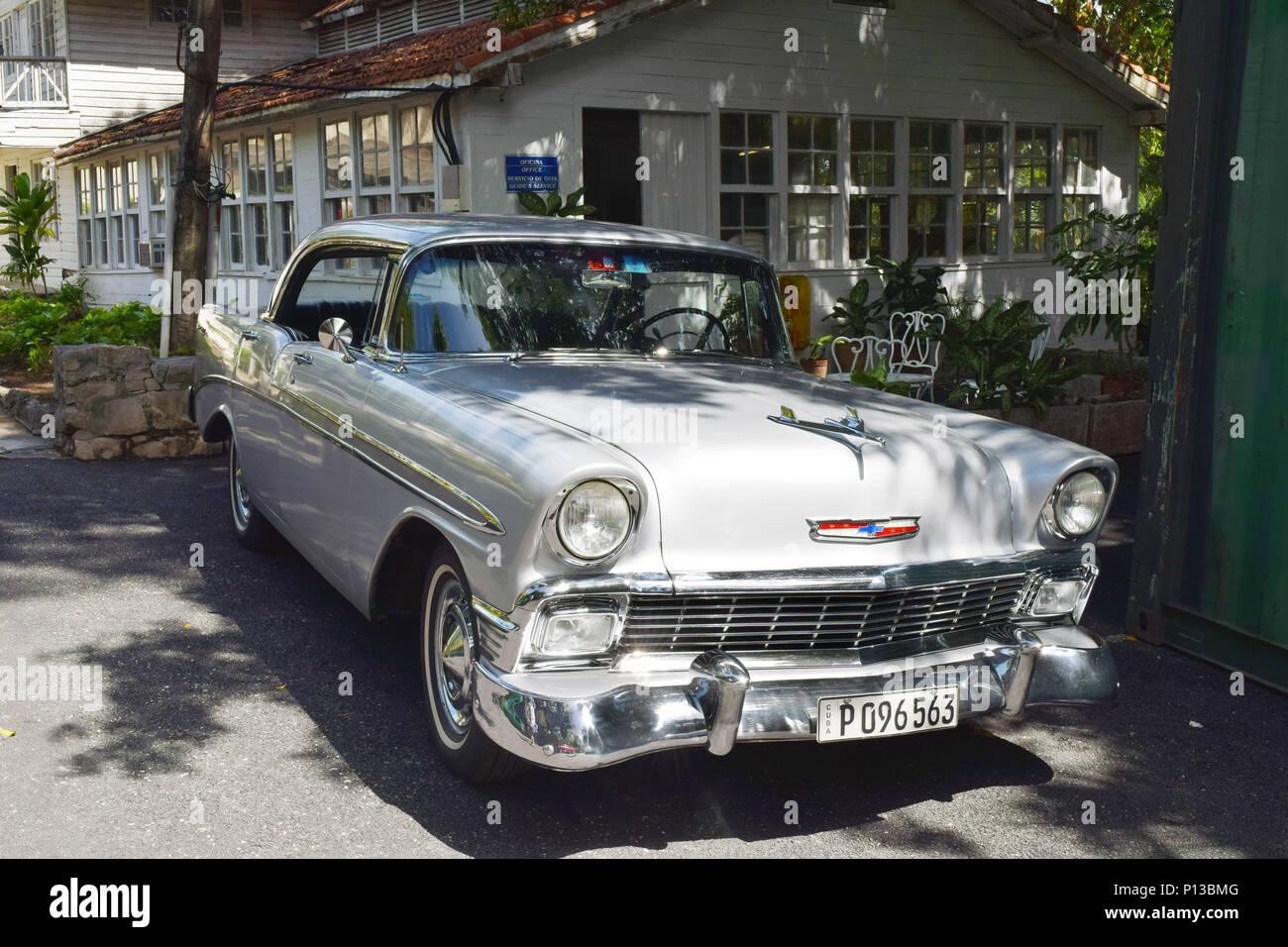 SAN FRANCISCO DE PAULA, CUBA - JUNE 10th, 2016: Ernest Hemingway's Chevrolet car at his house Finca Vigia, near Havana, Cuba. It is now a museum.  Mos Stock Photo