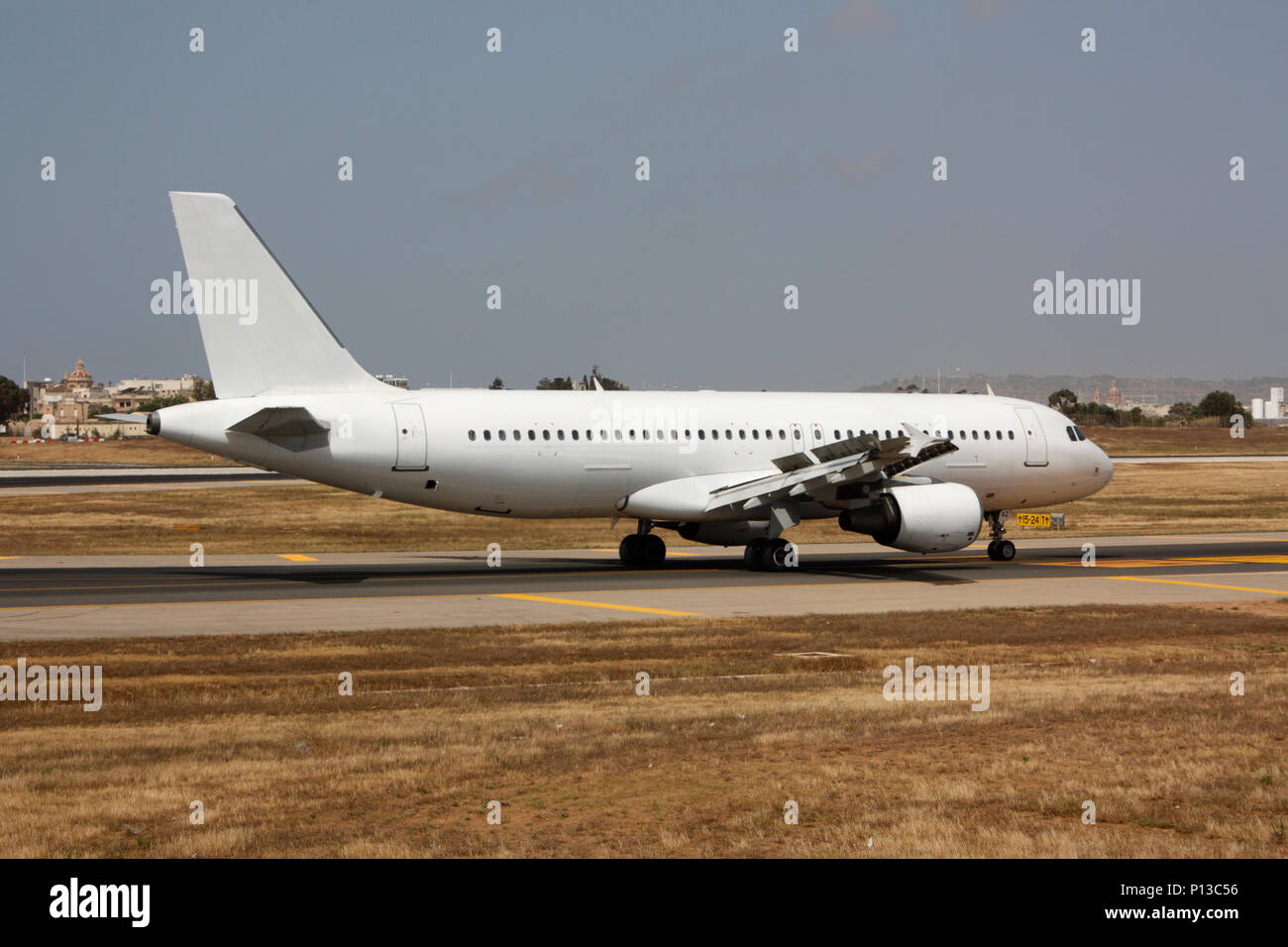 Airbus A320 commercial passenger jet aeroplane taxiing on a taxiway after landing. Proprietary details deleted and no persons visible. Air transport. - Stock Image