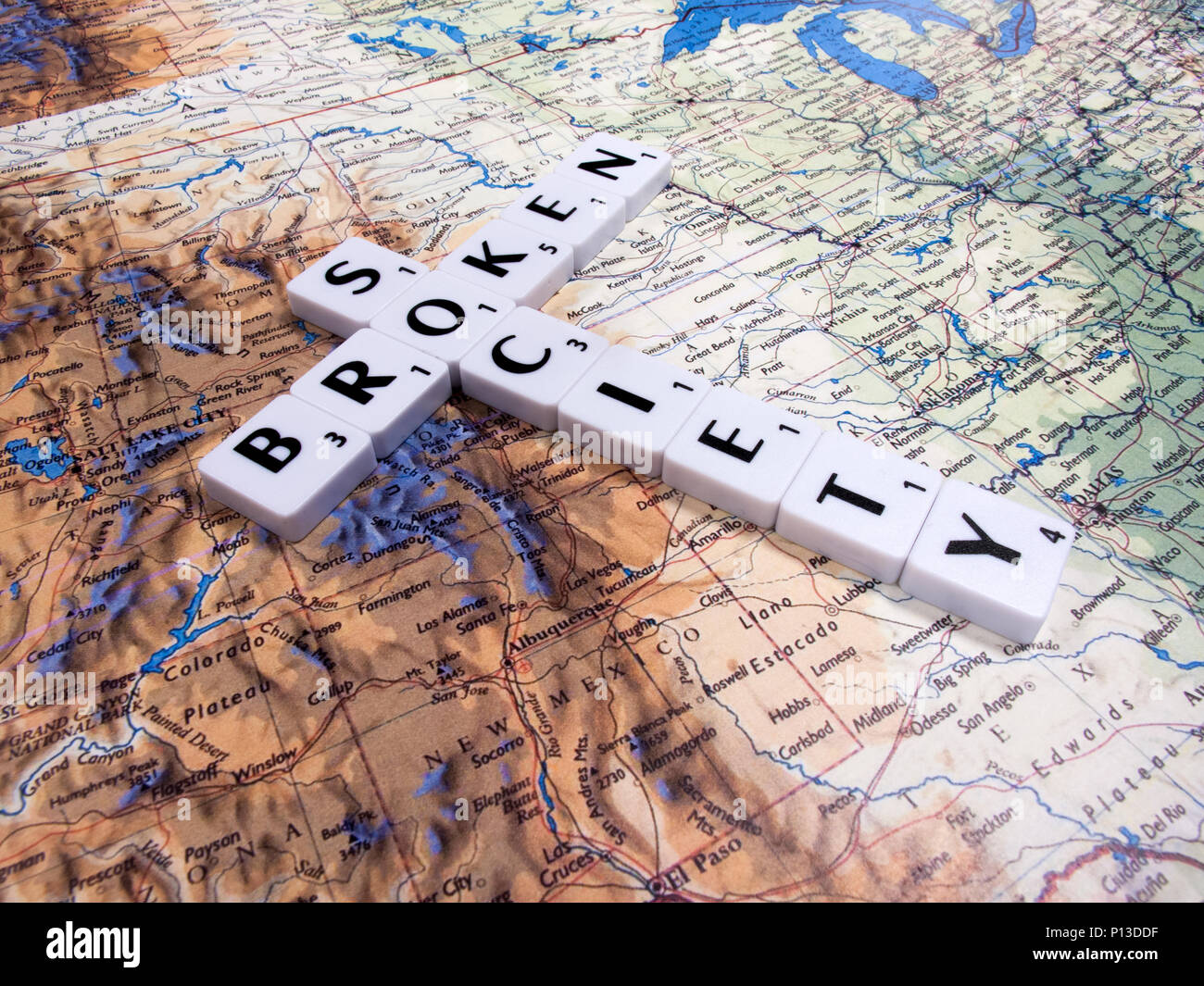 representation of broken society, a perceived or apparent general decline in moral values, with United States of America map background - Stock Image