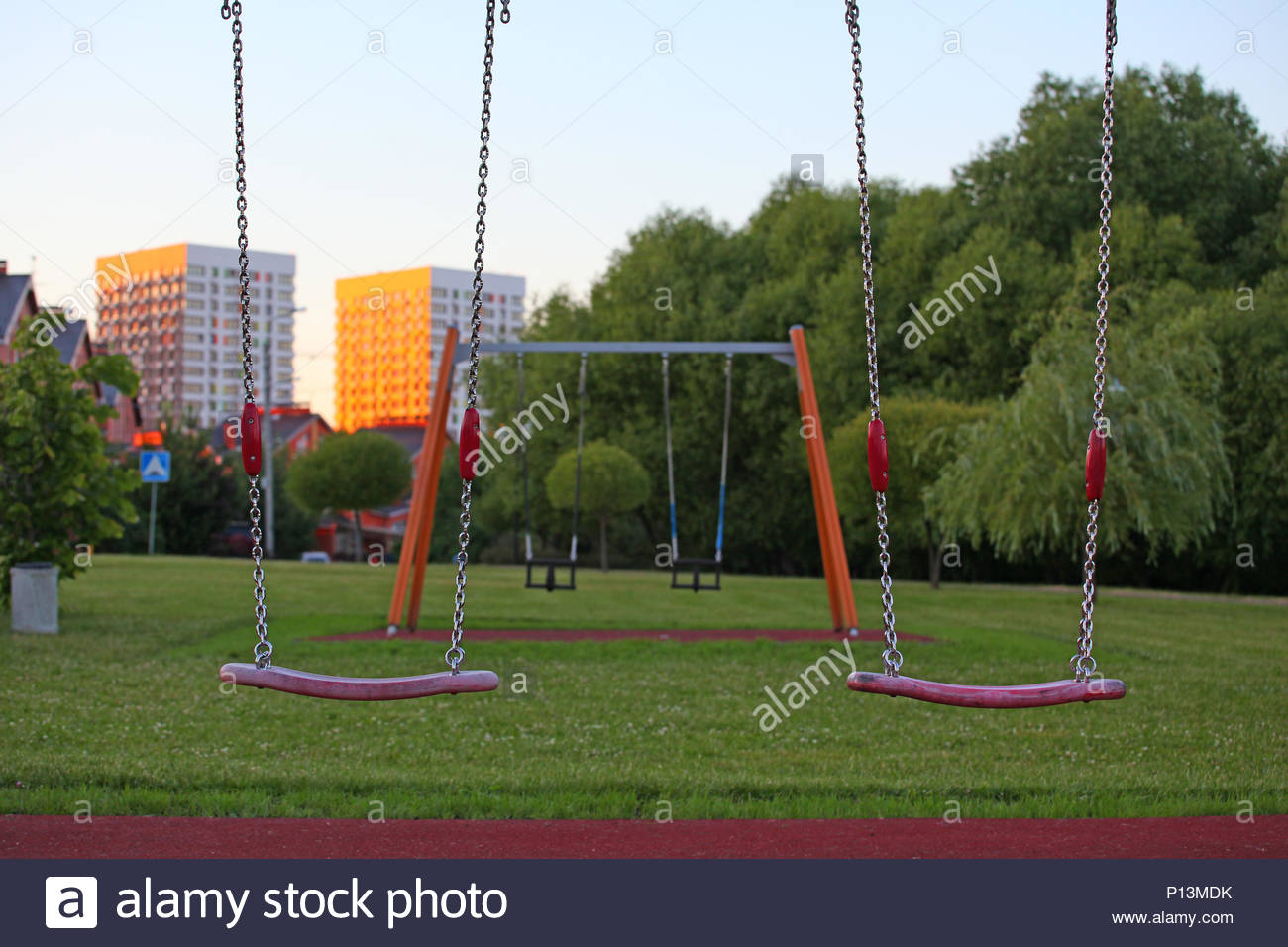 playground swing evening park - Stock Image