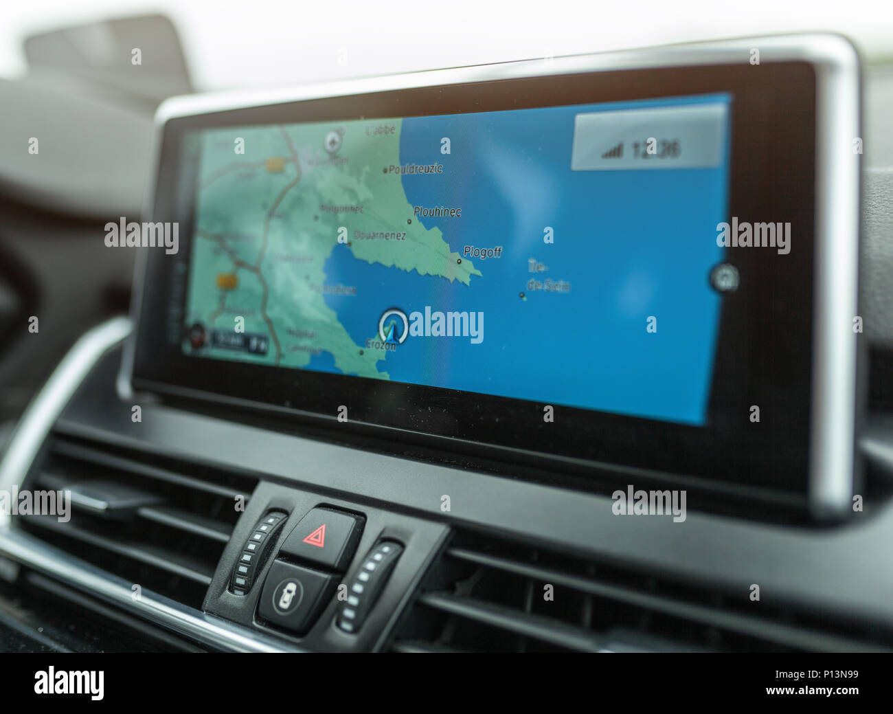 Close-up of gps navigation system device in travelling car. - Stock Image