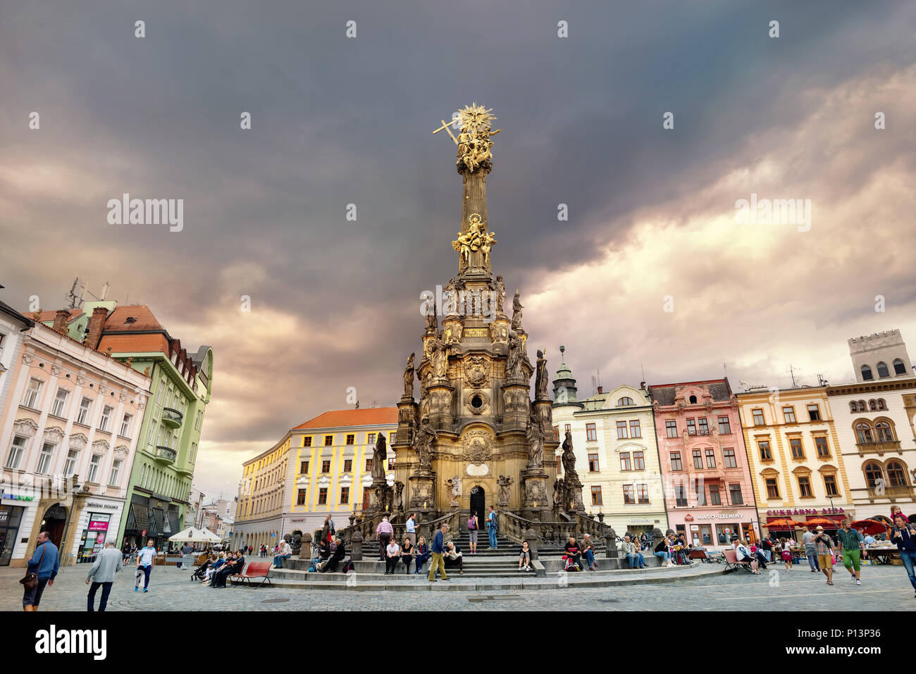 View of main square with monument Holy Trinity Column in historic town centre at sunset. Olomouc, Czech Republic - Stock Image