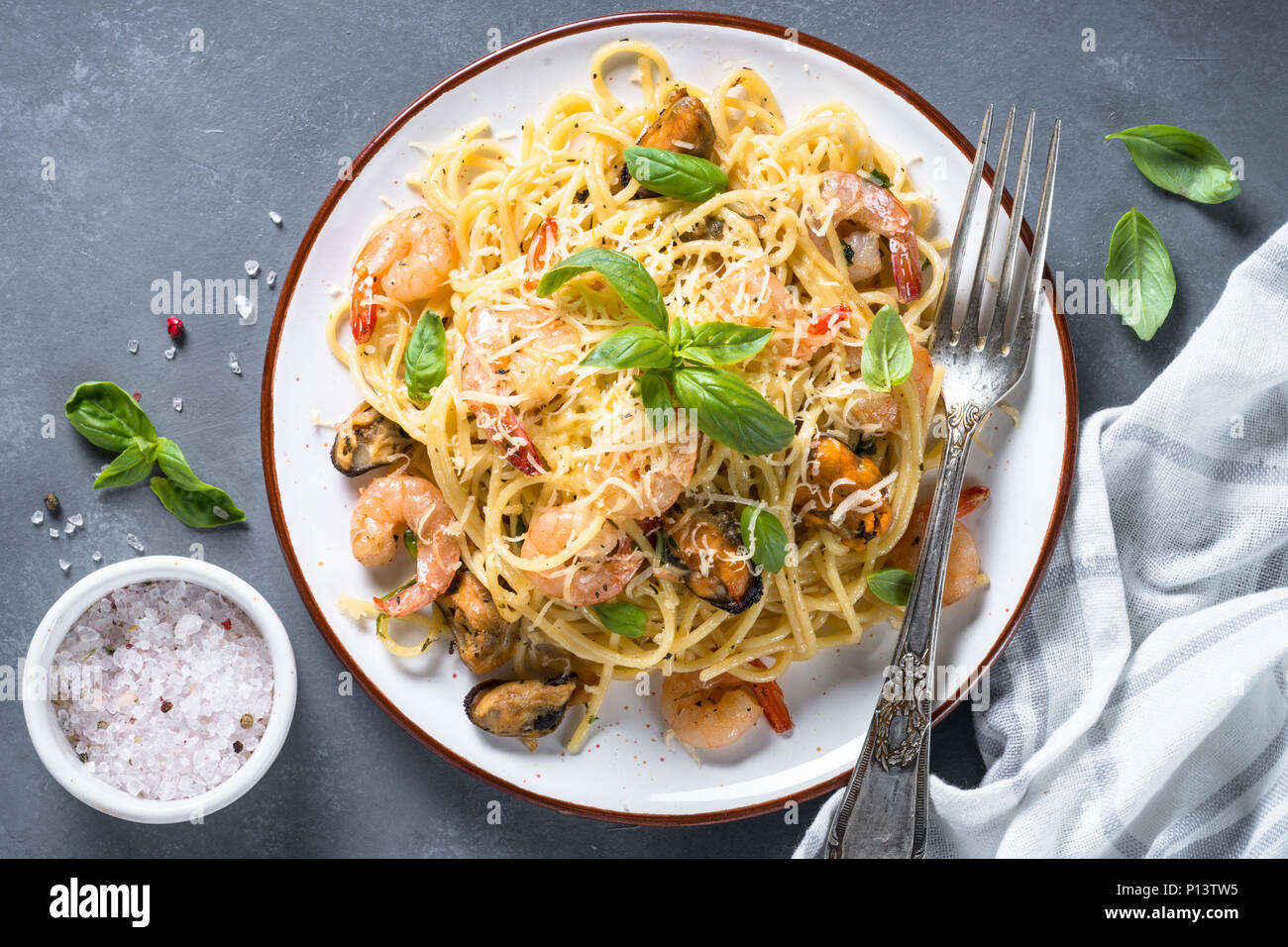 Pasta spaghetti with seafood and cream sauce. - Stock Image