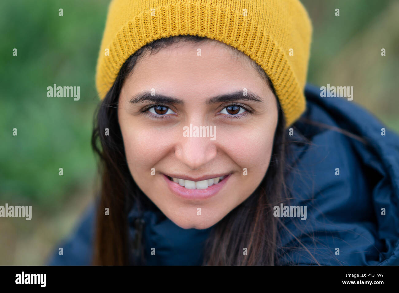 f6af6572 Young beautiful brunette woman smiling with yellow beret. - Stock Image