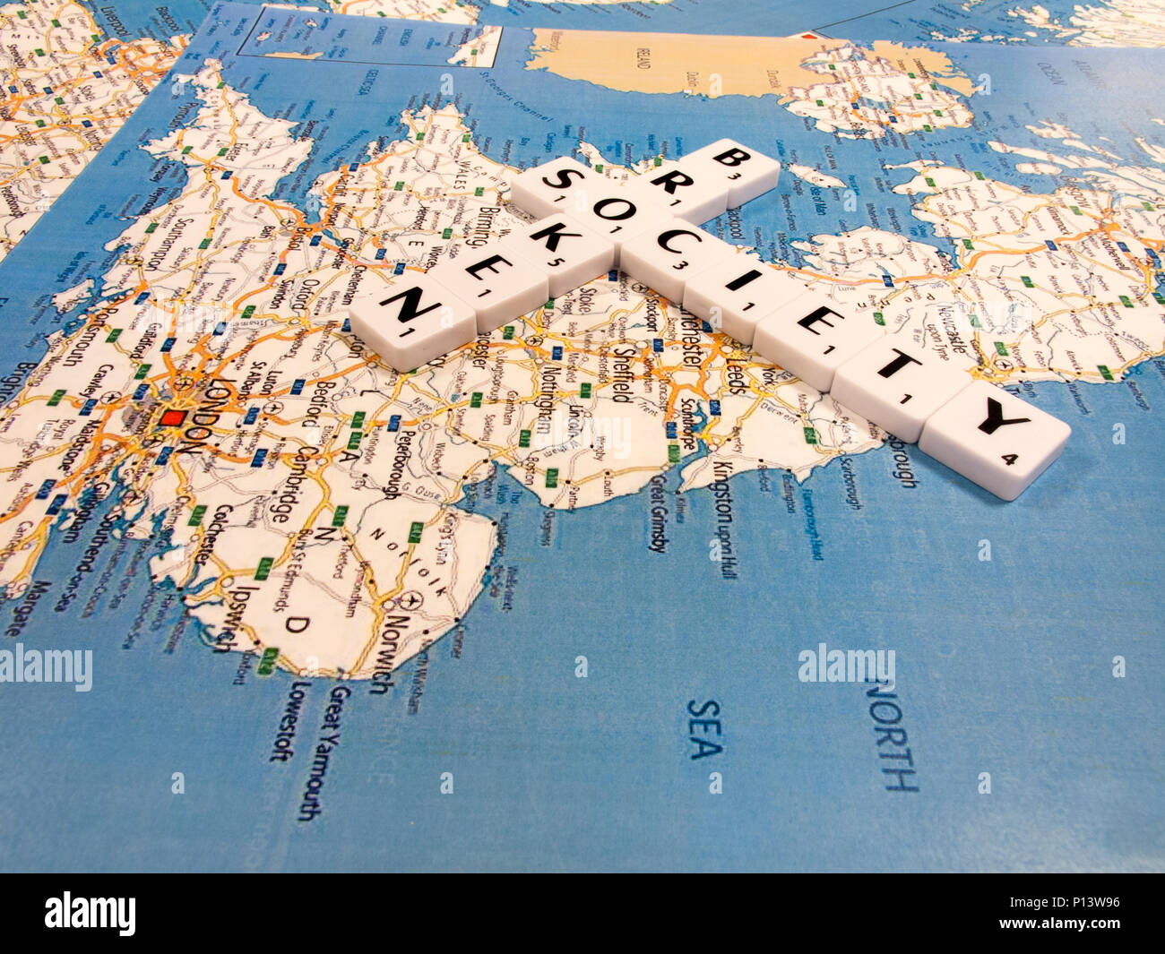 representation of broken society, a perceived or apparent general decline in moral values, with United Kingdom map background - Stock Image