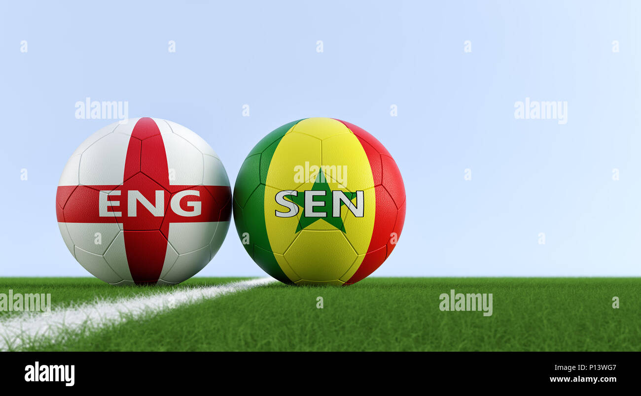 England vs. Senegal Soccer Match - Soccer balls in Englands and Senegals national colors on a soccer field. Copy space on the right side - Stock Image