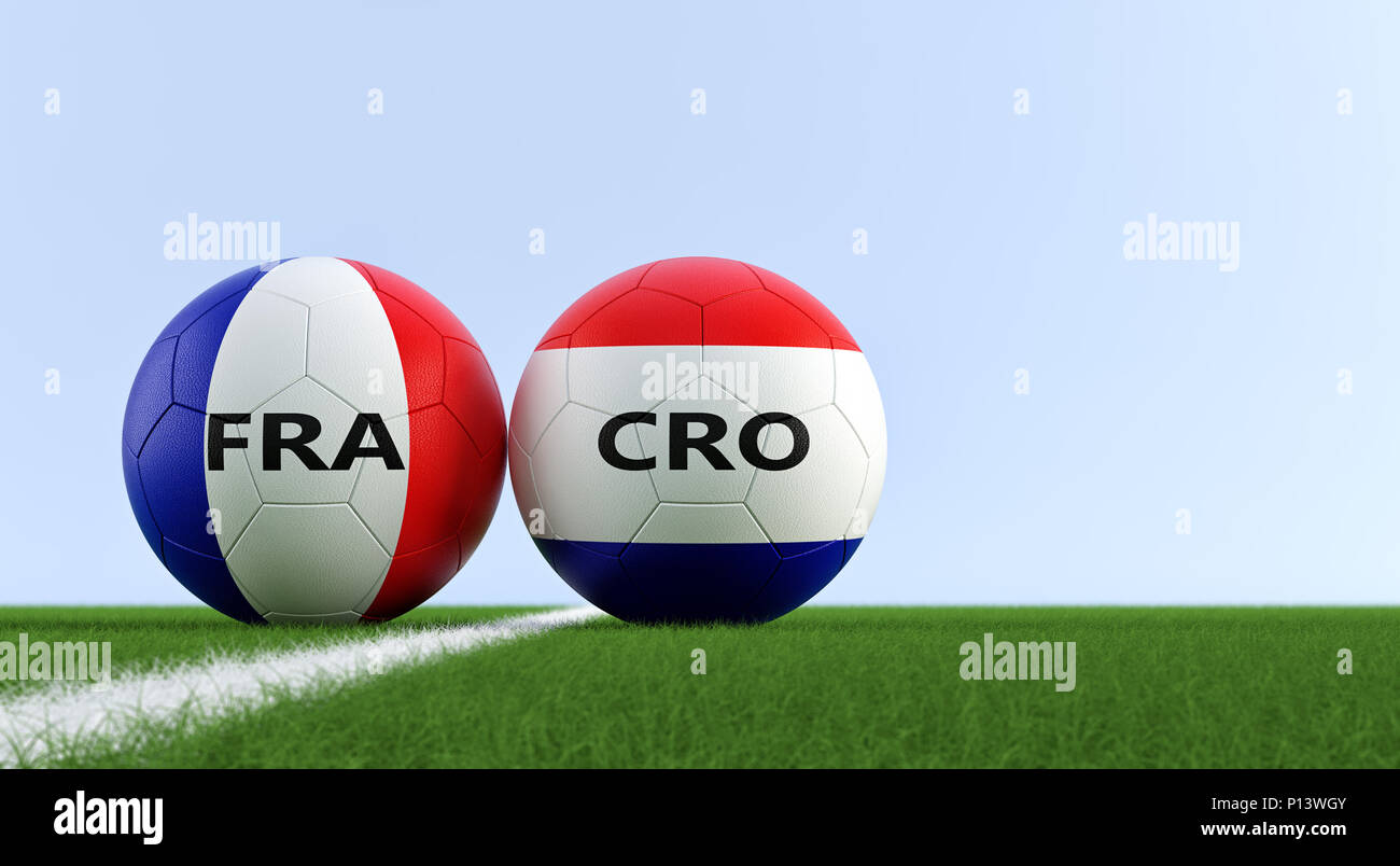 France vs. Croatia Soccer Match - Soccer balls in France and Croatia national colors on a soccer field. Copy space on the right side - Stock Image