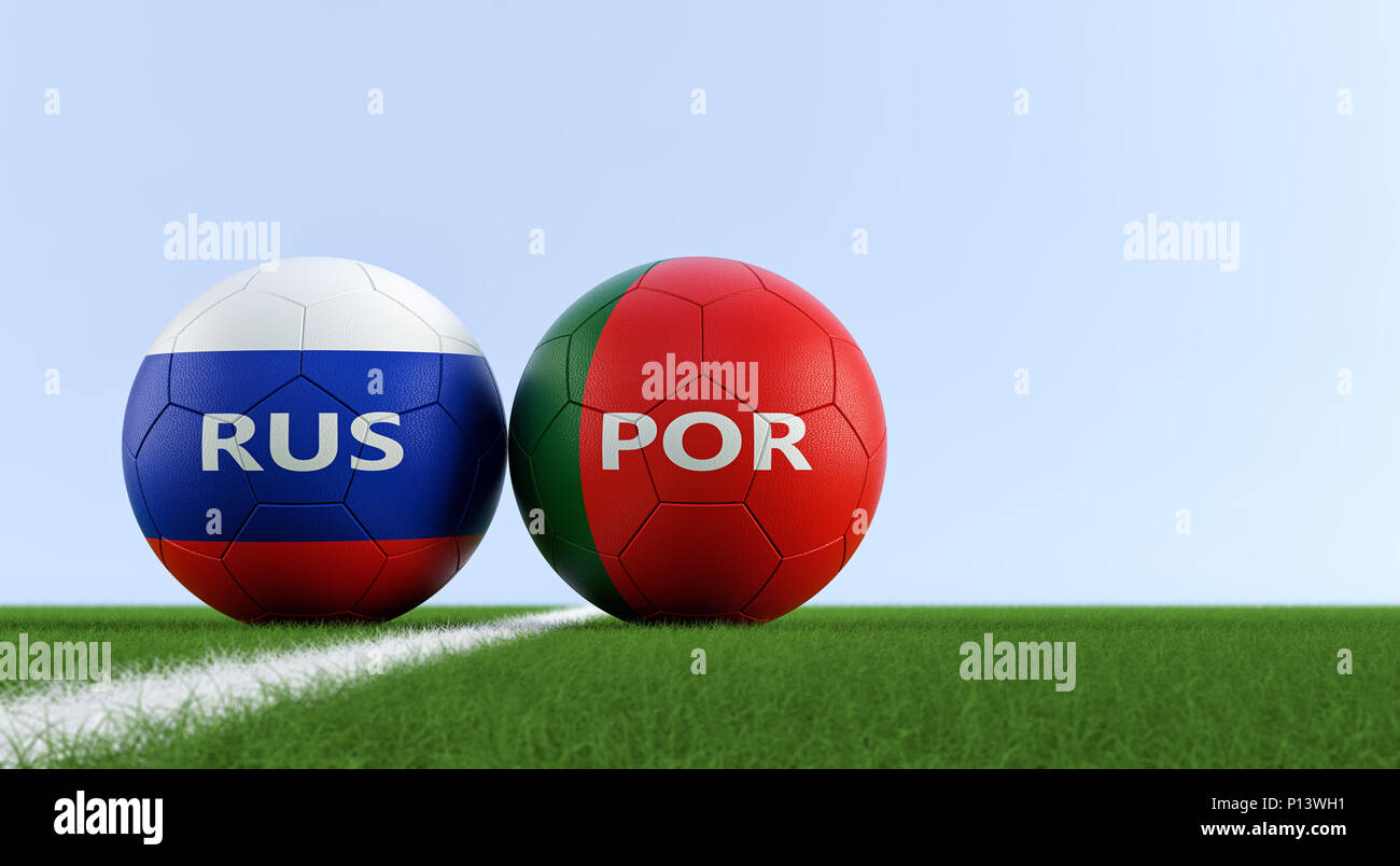 Portugal vs. Russia Soccer Match - Soccer balls in Portugals and Russian national colors on a soccer field. Copy space on the right side - Stock Image