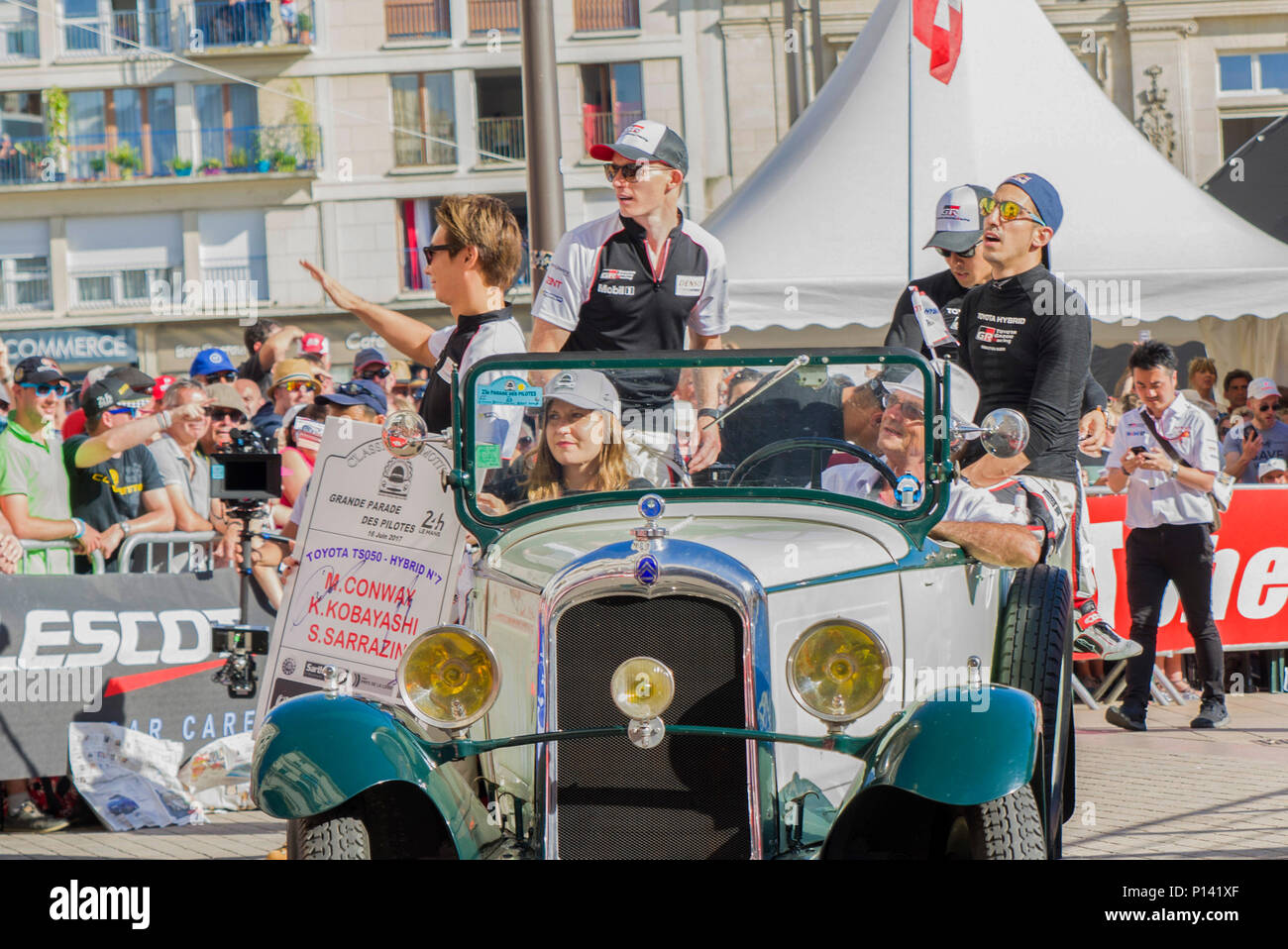 LE MANS, FRANCE - JUNE 16, 2017: Team of Toyota Racing drivers Kamui Kobayashi Stephane Sarrazin Mike Conway at a parade of pilots racing 24 hours of  Stock Photo