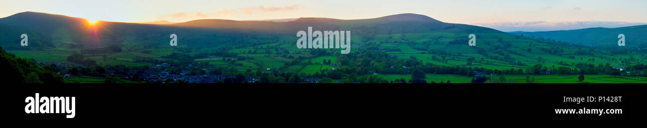 panoramic sunset picture of walkers on The Great Ridge Night Light in the Peak District National Park at the start of the BMC's Mend Our Mountains, a  - Stock Image