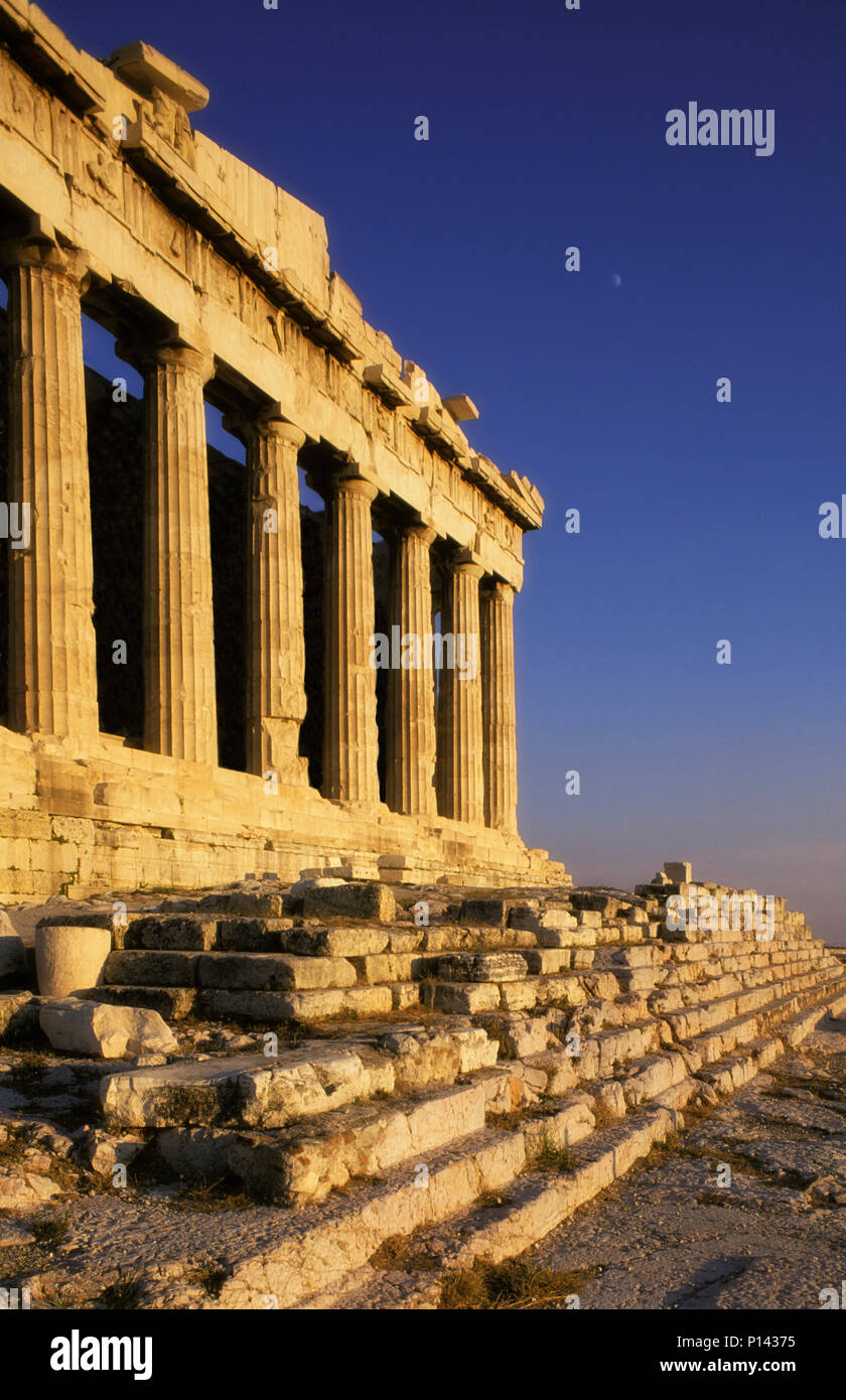 Athens Acropolis: Parthenon, close side view, from the northwest, depicting the altar stairs with late light and a partial moon, Athens, Greece Stock Photo