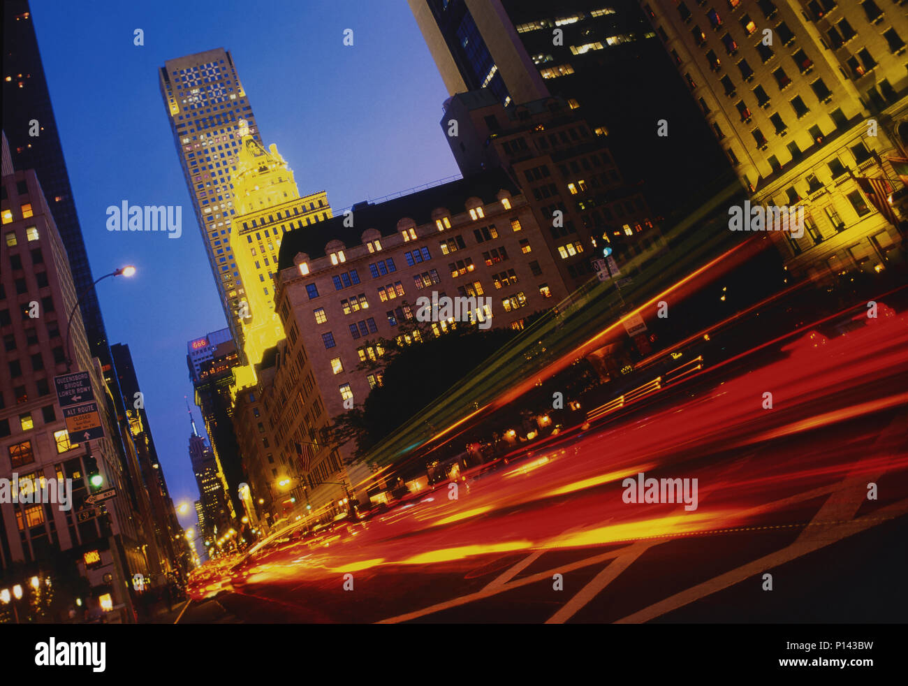 New York City on 5th Ave, looking south, with traffic streaks and illuminated buildings at dusk, New York, NY, USA Stock Photo