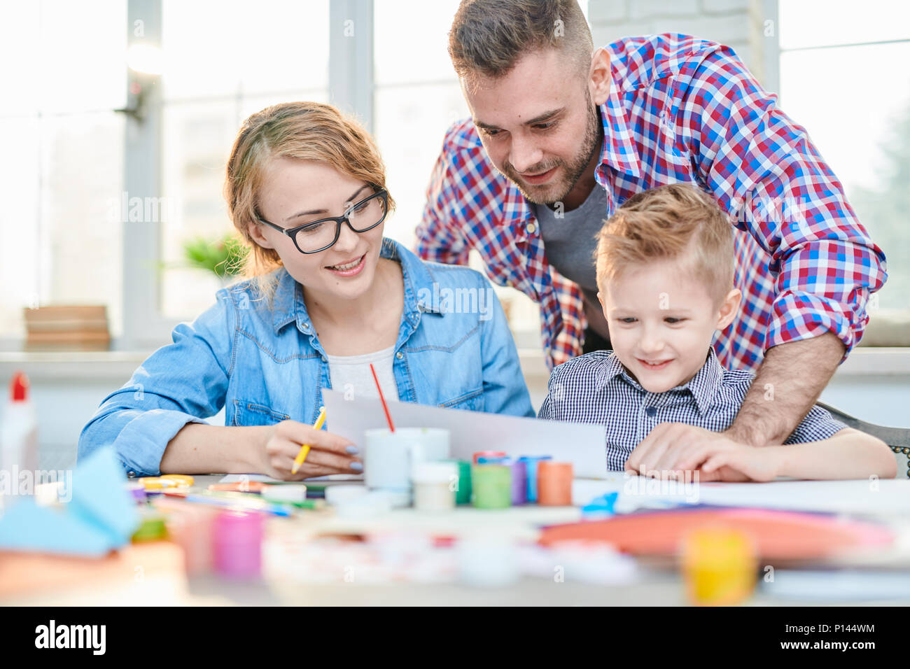 Loving Family Expressing Creativity - Stock Image