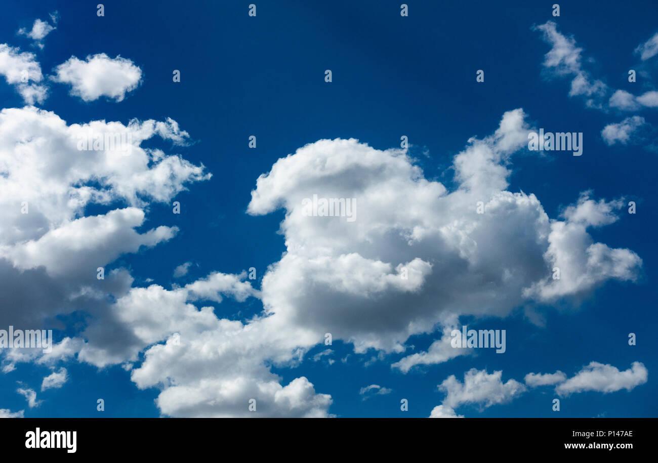Cumulousnimbus clouds against a blue sky - Stock Image