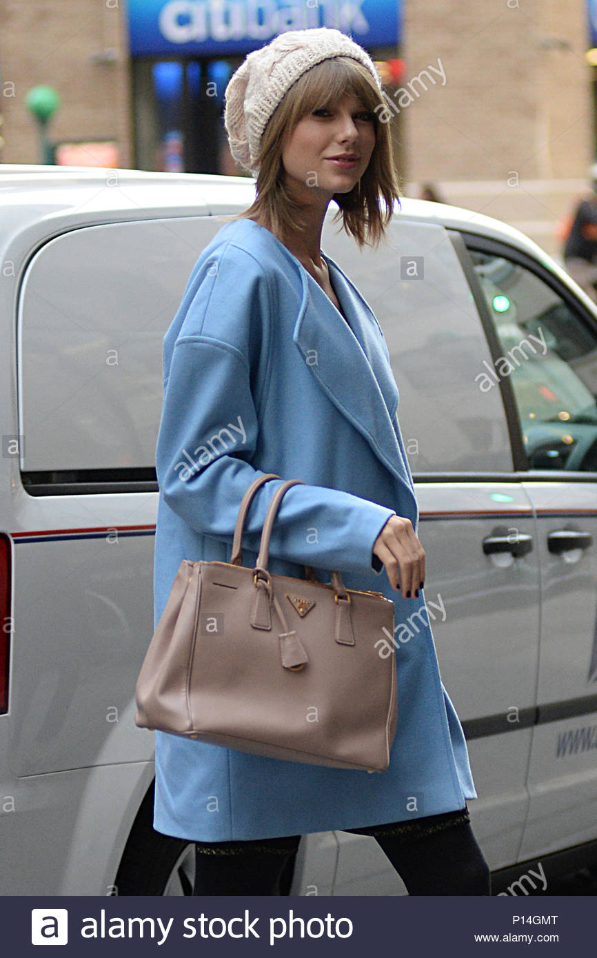 b5b6cd29f129 ... TO READ INFPhoto.com ONLY***<BR/> Taylor Swift seen out and about,  keeping herself stylish in a beanie and powder blue coat and carrying a Prada  purse.