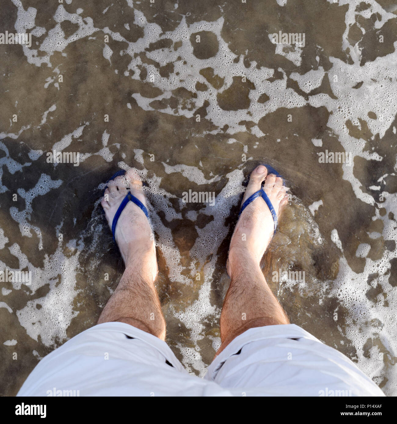 226245c7eec022 ... purchase cheap e374a 452cf Square POV instagram-style shot of feet in  ocean with flip ...