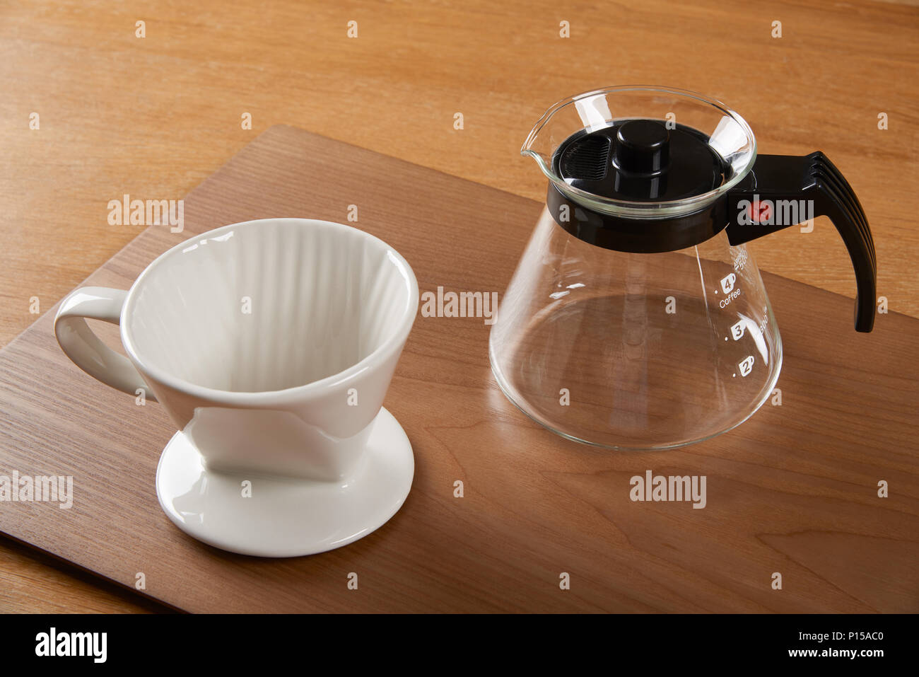 ceramic hand drip coffee brewer (dripper) and glass server (carafe) - Stock Image