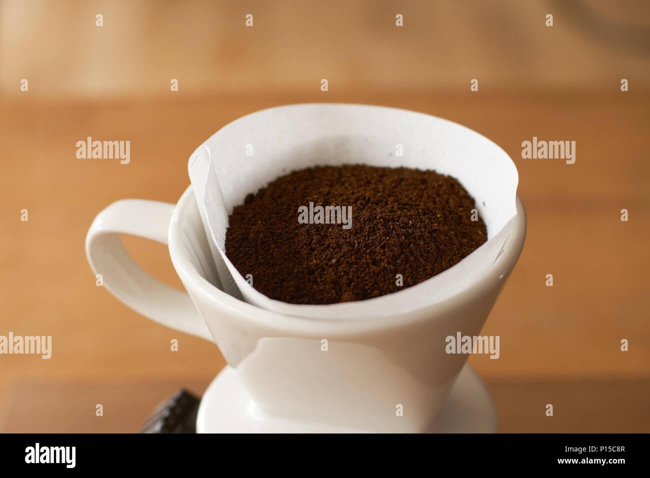 ceramic hand drip coffee brewer (dripper) and drip ground coffee - Stock Image
