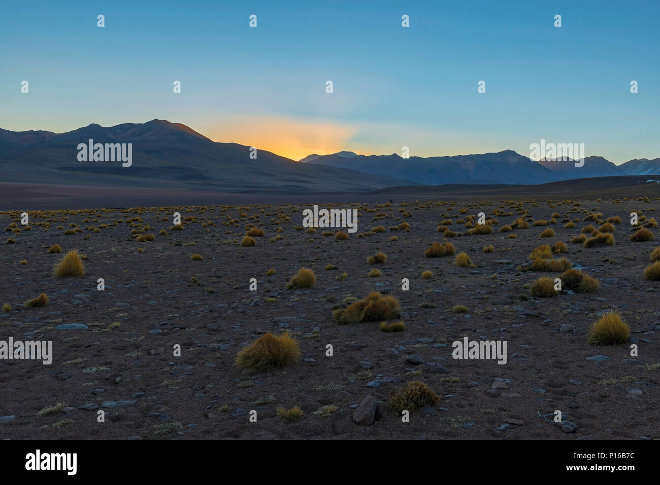 Landscape of the Andes mountain range at sunrise in the Siloli desert at 4600m high located between Chile and the Uyuni salt flat, Bolivia. - Stock Image