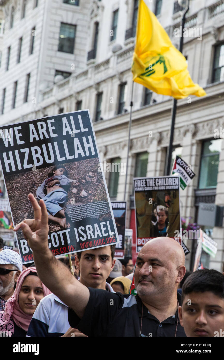 London, UK. 10th June, 2018. A Hezbollah flag flies above hundreds of people taking part in the pro-Palestinian Al Quds Day march through central London organised by the Islamic Human Rights Commission. An international event, it began in Iran in 1979. Quds is the Arabic name for Jerusalem. Credit: Mark Kerrison/Alamy Live News - Stock Image