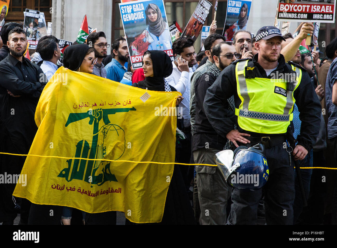 London, UK. 10th June, 2018. A Hezbollah flag among hundreds of people taking part in the pro-Palestinian Al Quds Day march through central London organised by the Islamic Human Rights Commission. An international event, it began in Iran in 1979. Quds is the Arabic name for Jerusalem. Credit: Mark Kerrison/Alamy Live News - Stock Image