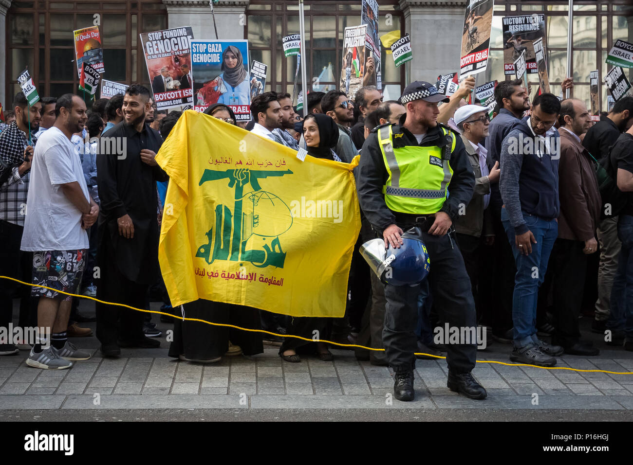 London, UK. 10th June, 2018. Hezbollah flags fly at Al Quds Day rally and march through central London. Credit: Guy Corbishley/Alamy Live News - Stock Image