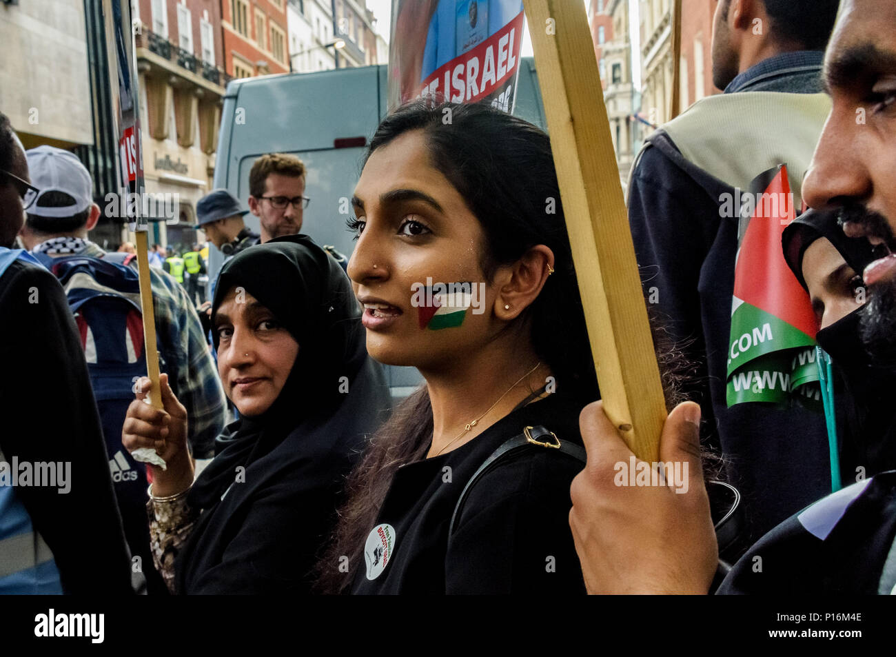 June 10, 2018 - London, UK. 10th June 2018. A large crowd squashed into the street in front of the Saudi Arabian embassy for a rally in support of the oppressed people of Palestine and others around the world. The event, organised by the Justice for Palestine Committee, is supported by the Islamic Human Rights Commission and a wide range of pro-Palestinian organisations, and was opposed by the Zionist Federation and some right wing hooligans, who were stopped from attacking the peaceful event by a large police presence in the area. Celebrated in many countries, the day, established by the Isla - Stock Image