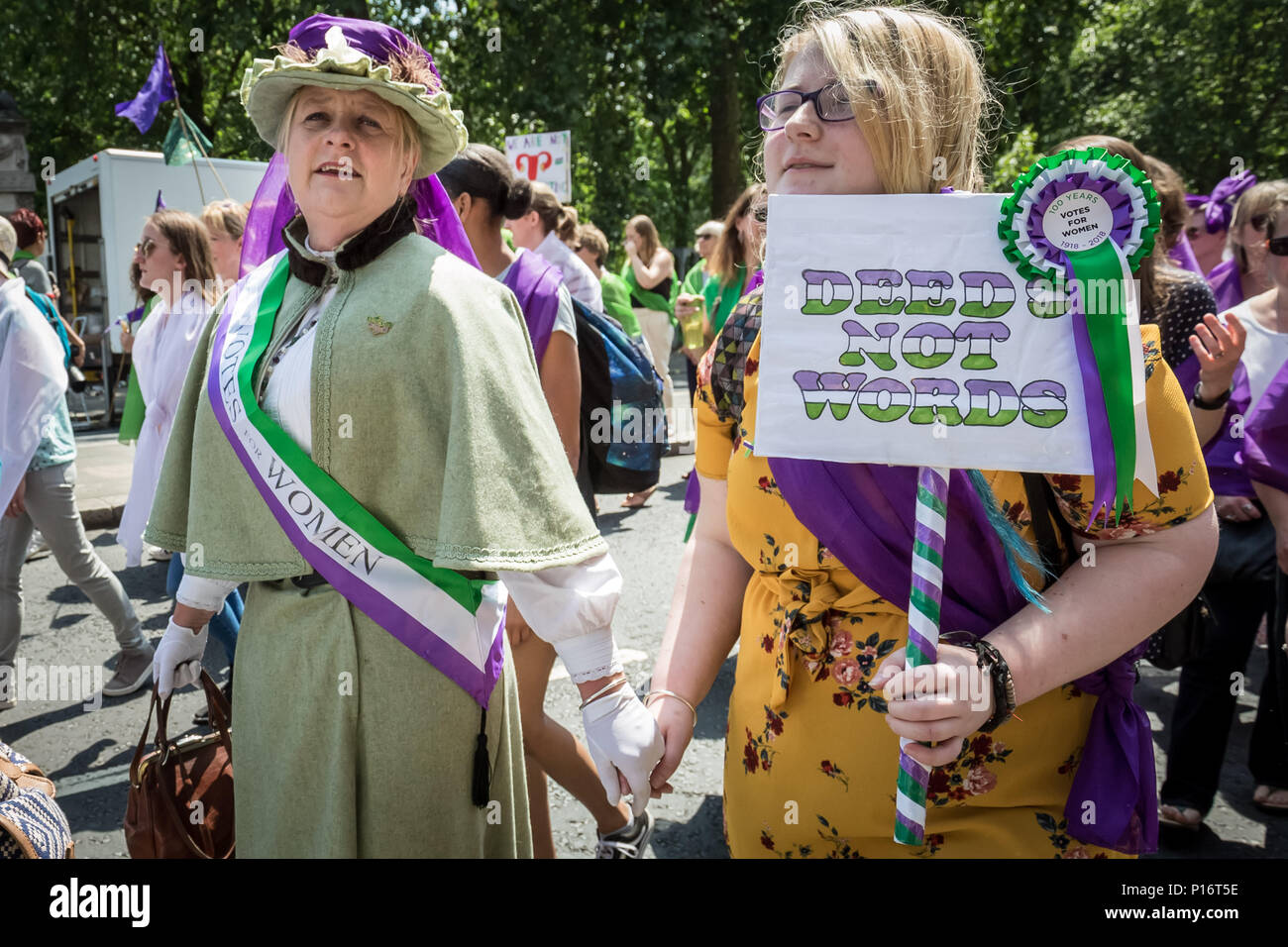 London, UK. 10th June 2018. Thousands of women join Processions 2018. Dressing in the green, white and purple tri-colour scheme of the Suffragette's Women's Social and Political Union, they marched from Hyde Park to Parliament Square to mark 100 years since the Representation of the People Act, which gave British women the right to vote and stand for public office in the UK. Credit: Guy Corbishley/Alamy Live News Stock Photo