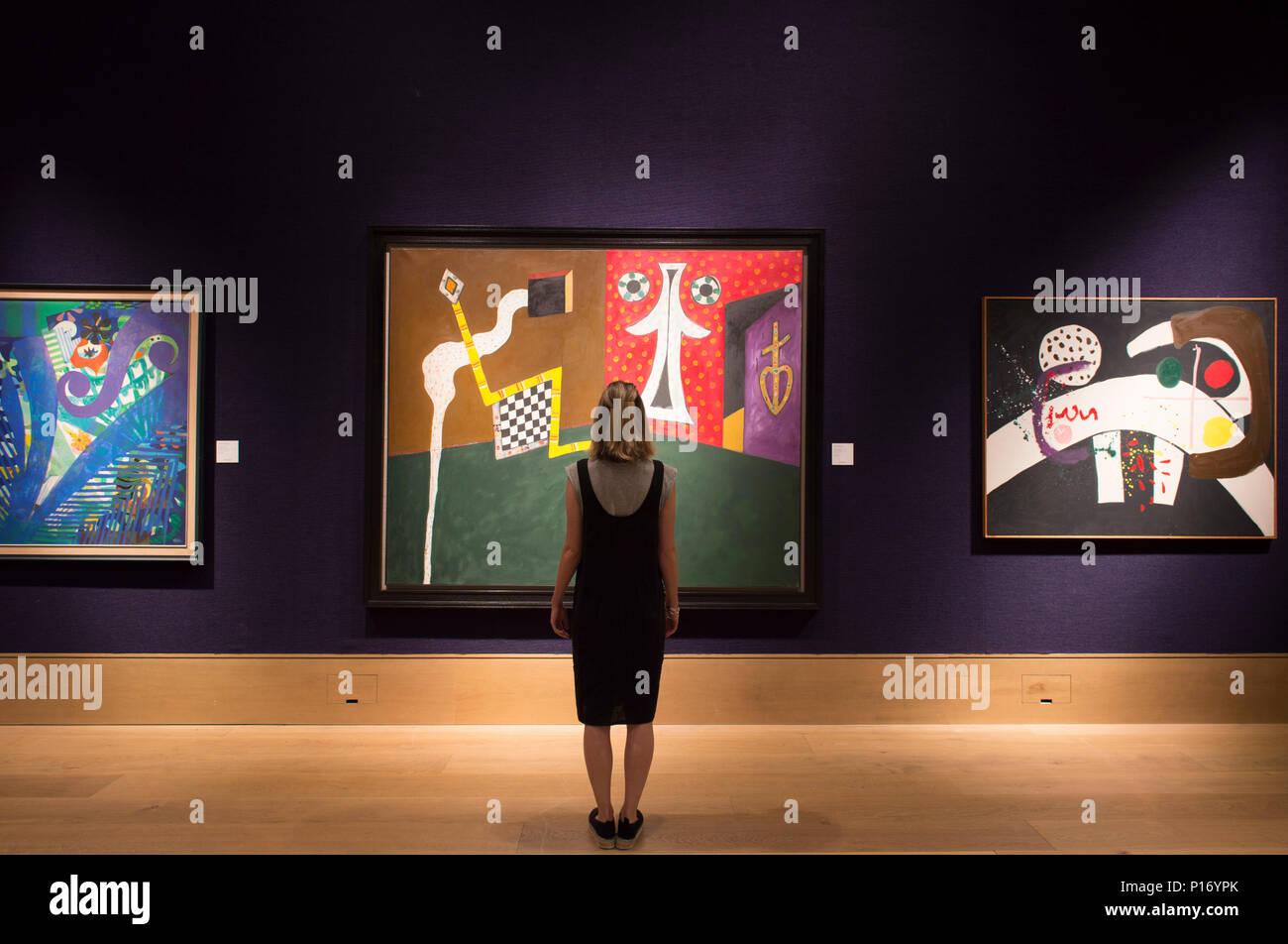 Bonhams, New Bond Street, London, UK. 11 June, 2018. Contemporary works on display at Bonhams Modern British and Irish Art Sale in London. Posed with member of Bonhams press staff. Credit: Malcolm Park/Alamy Live News. - Stock Image