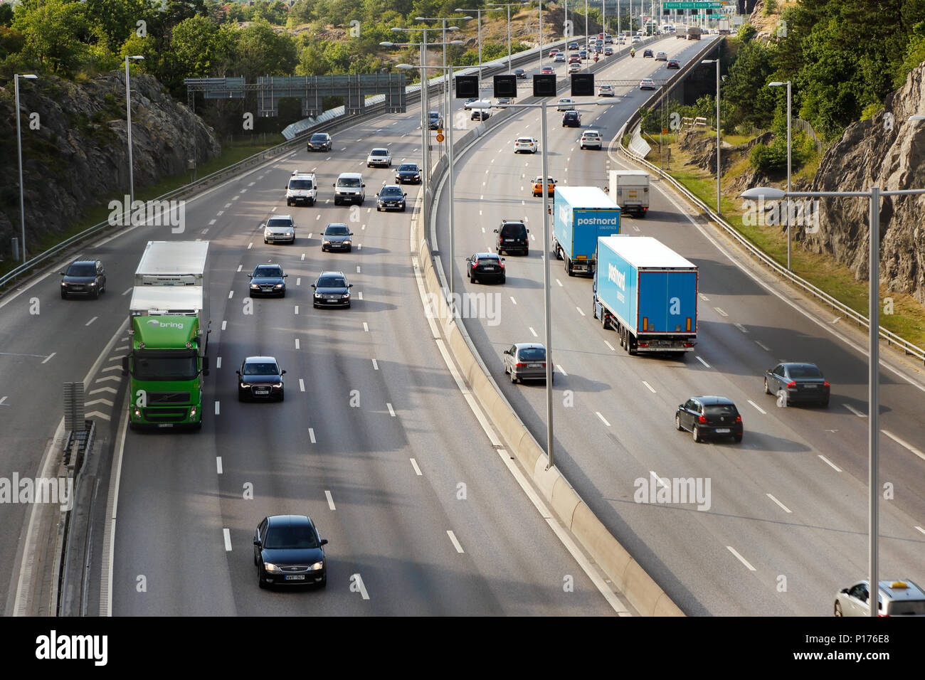 Stockholm, Sweden - July 8, 2016: High angel view of the freeway Essingleden hosting the roads E4 and E20 at Nyboda looking north. - Stock Image
