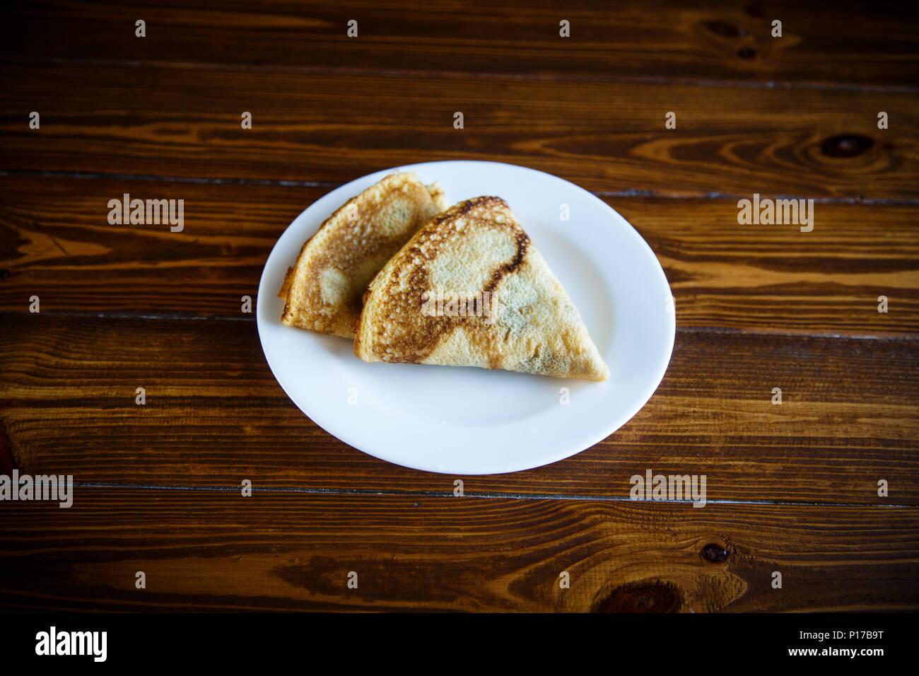 fried pancakes thin - Stock Image