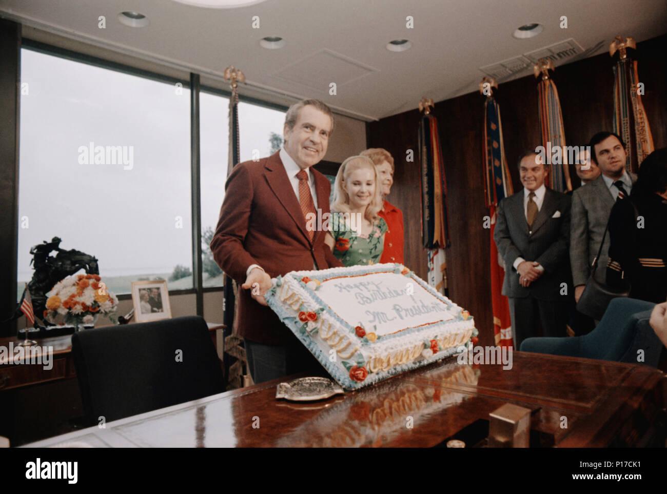 President Nixon admires his 61st birthday cake while