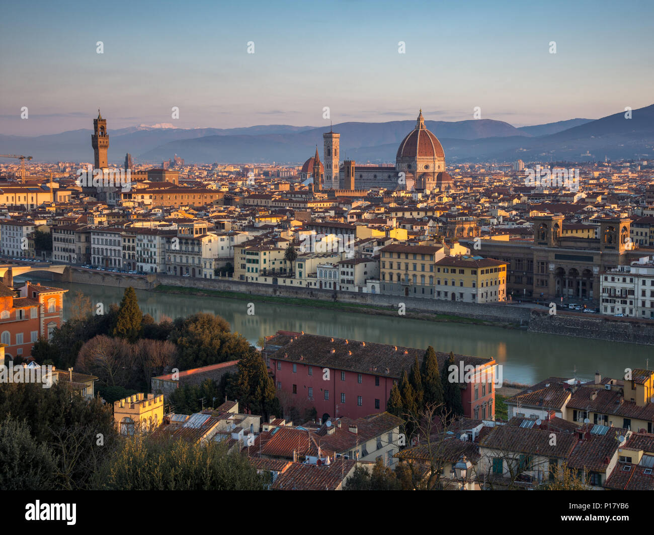 Florence, Italy - March 24, 2018: Morning light illuminates the cityscape of Florence, including the historic landmarks of Palazzo Vecchio and the Duo Stock Photo