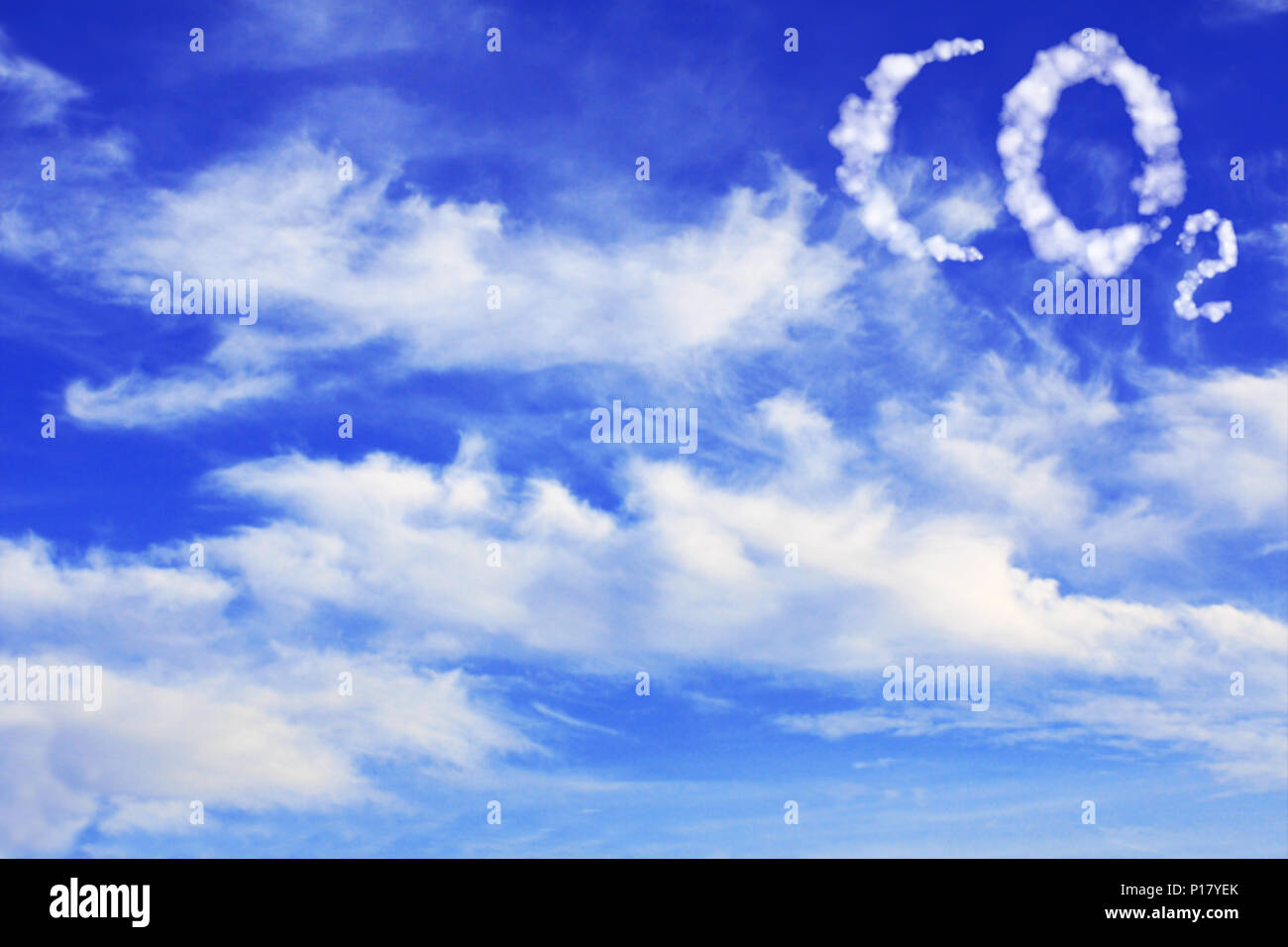Symbol CO2 from clouds on blue sky - Stock Image