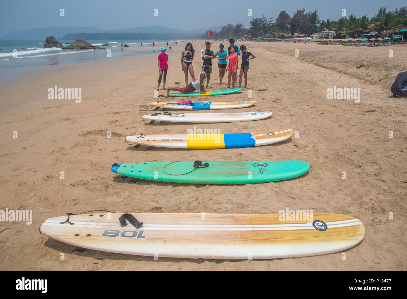 A bunch of boards on the beach during the start of surfing lessons on Agonda beach in Goa, India. - Stock Image